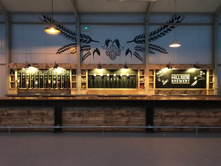 Hillside Brewery Bar with a wide range of beers and fully stocked with other drinks.