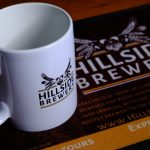 Hillside Brewery branded mugs.
