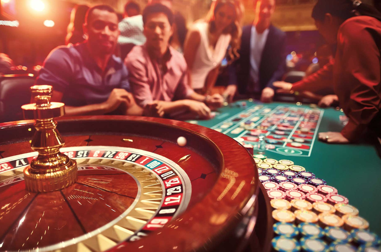 Casino night using fun money, including blackjack and roulette tables.