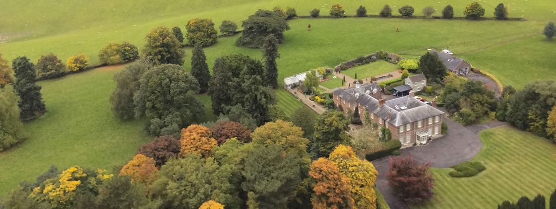 Local accommodation Wharton Lodge with picturesque grounds and dog friendly.