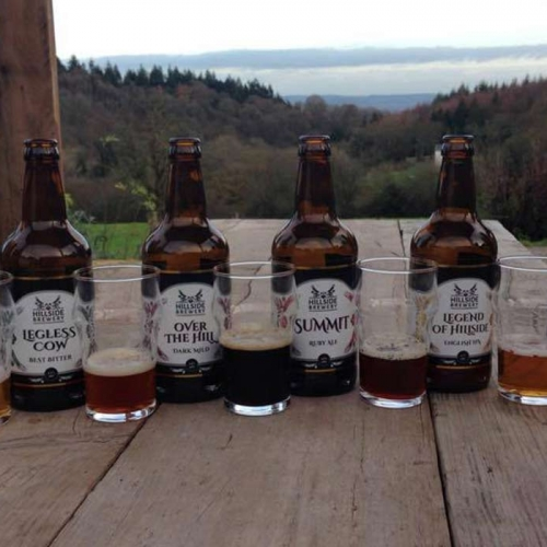 Range of Hillside Brewery Beers available with nice view in the background