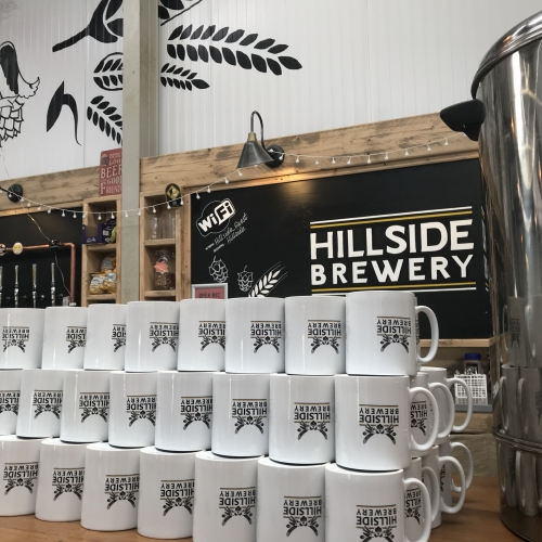 Stacked mugs at one of our corporate events at Hillside Brewery.