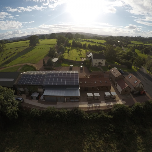 Drone view of Hillside brewery's buildings and the view of Gloucestershire and The Wye Valley.
